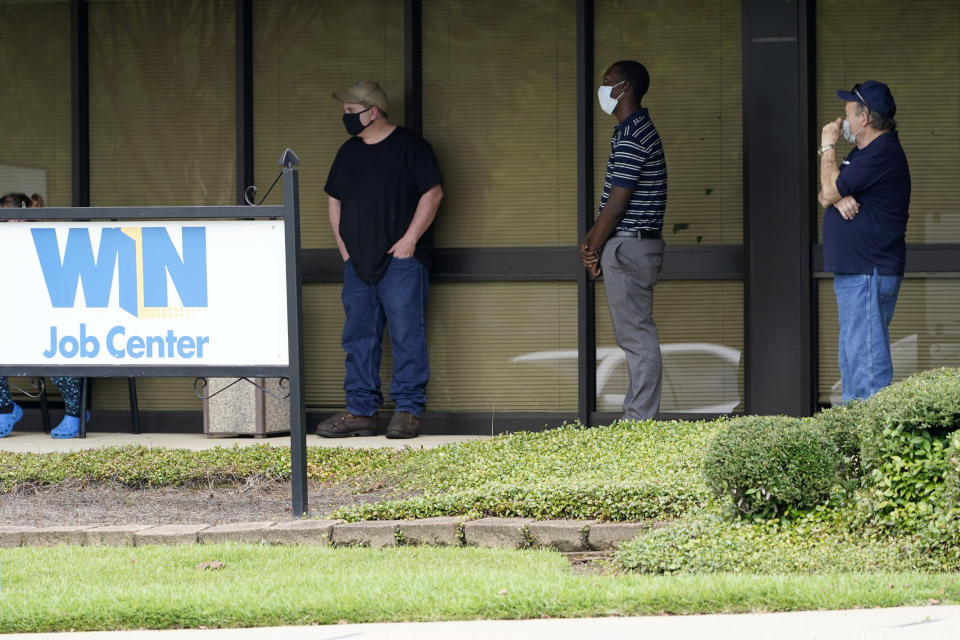 Clients line up outside the Mississippi Department of Employment Security WIN Job Center in Pearl, Miss., Monday, Aug. 31, 2020. The U.S. economy's economic engine may be running out of fuel. Consumer spending accounts for about 70% of the U.S. gross domestic product, making it the single most important factor in recovering from one of the worst recessions on record. (AP Photo/Rogelio V. Solis)