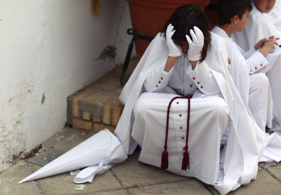 "A penitent of ""La Paz"" (The Peace) brotherhood cries after the governing body of his brotherhood decided that penance could not be carried out in the streets due to rain during Holy Week in the Andalusian capital of Seville, southern Spain."