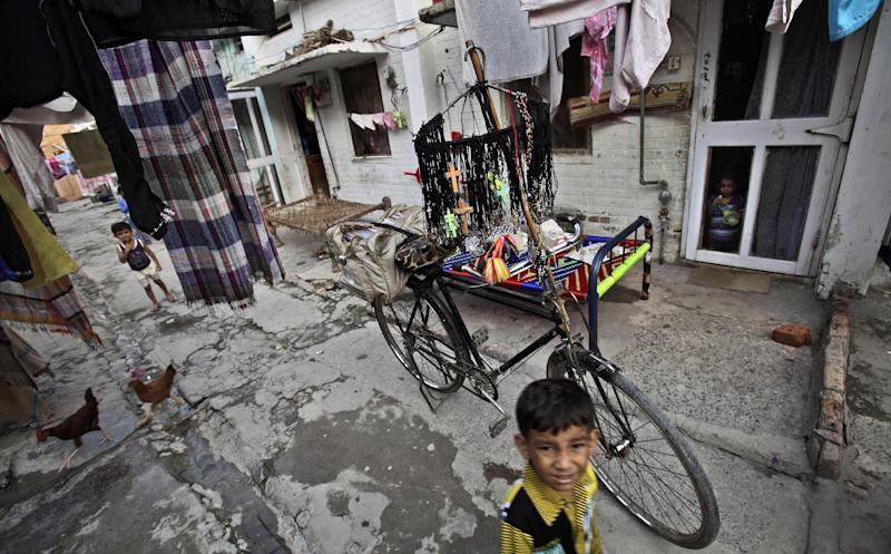 A Pakistani Christian vendor, not pictured, displays crosses on his bicycle for sale, in a Christian neighborhood in Islamabad, Pakistan, Monday, Aug. 20, 2012. Pakistani authorities arrested a Christian girl and are investigating whether she violated the country's strict blasphemy laws after furious neighbors surrounded her house and demanded police take action, a police officer said Monday. The arrest of the girl and outrage among the local community demonstrates the deep emotion that suspected blasphemy cases can evoke in this conservative Muslim country, where rising extremism often means religious minorities live in fear of persecution.(AP Photo/Muhammed Muheisen)