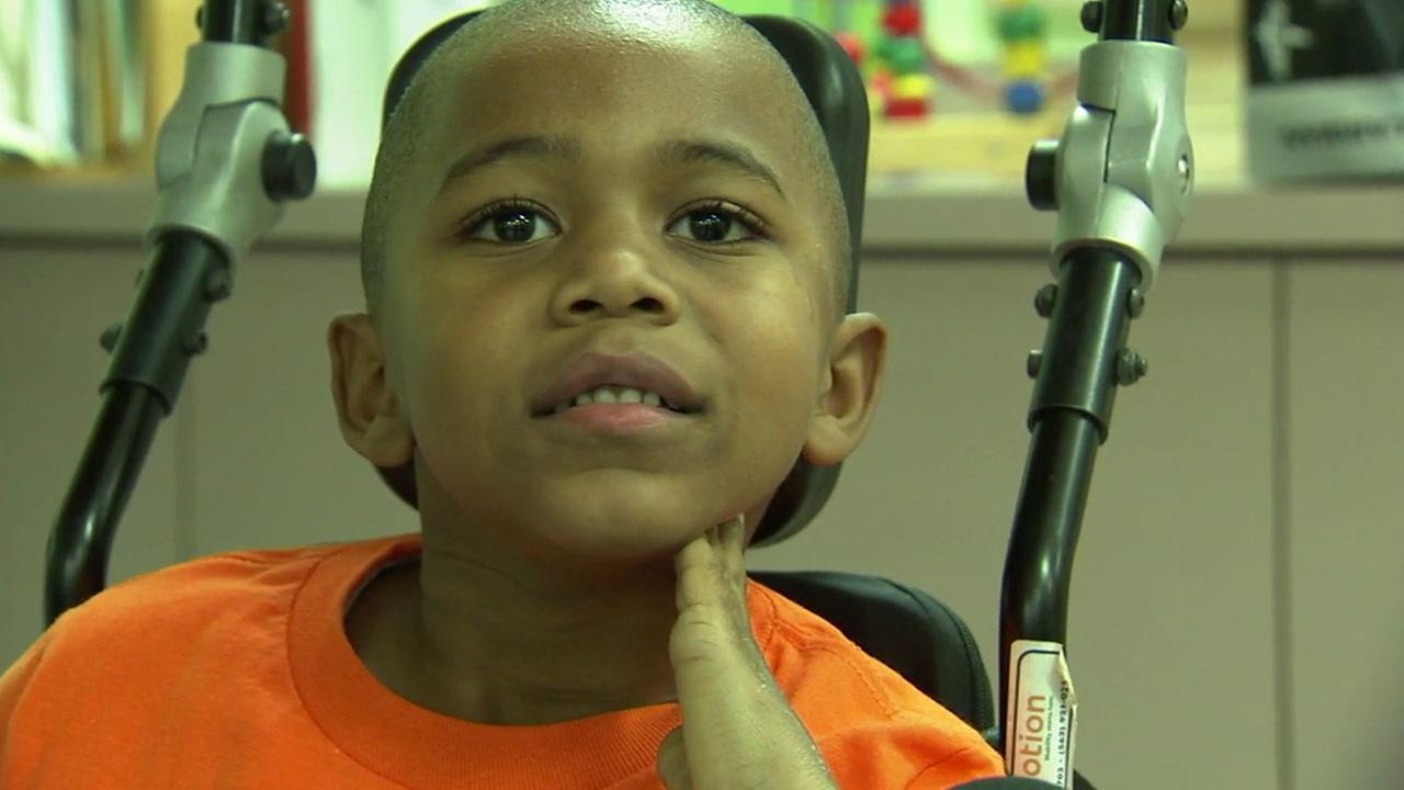 A rehabilitation center is helping a boy who was shot and paralyzed from the chest down in January progress faster than doctors thought was possible.