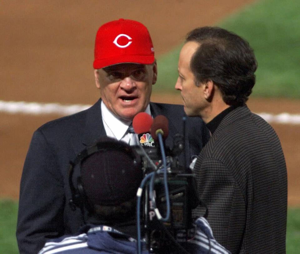 Pete Rose is interviewed by NBC's Jim Gray after the All-Century introductions before the second game of the 1999 World Series at Turner Field in Atlanta, Ga., Sunday Oct. 24, 1999.  NBC was deluged by complaints from fans in the hours after Gray's interview during Sunday's World Series pregame show. It centered on Rose's lifetime ban from the sport for gambling, and came minutes after Rose was announced as a member of baseball's All-Century team. (AP Photo/Mandatory Credit, Michael Schwarz) NO MAGS NOSALES