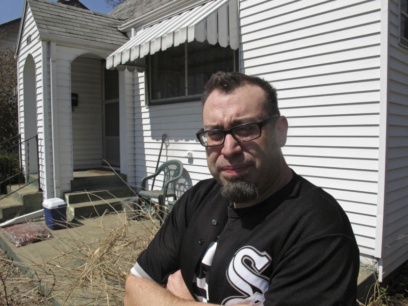 In this April 5, 2013 file photo, Michael Esteves stands outside and talks about the home he owns in Urbana, Ill., that was once the boyhood home of film critic Roger Ebert. Through his television shows, movies reviews and essays, Ebert belonged to the world beyond Urbana. One part of Ebert's life that got little attention as the nation mourned his sudden death April 4 was how much he meant to this university town where he grew up. (AP Photo/David Mercer, File)