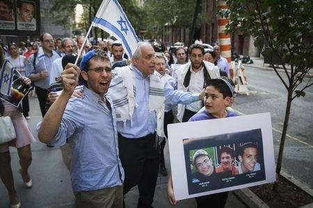 Rabbi Avi Weiss marches with demonstrators during a memorial service near the United Nations headquarters, for three missing Israeli teenagers whose bodies were found in the occupied West Bank, in New York