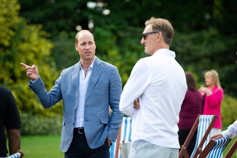 The Duke of Cambridge chats with former Arsenal footballer Tony Adams, during a screening of the Heads Up FA Cup Final between Arsenal and Chelsea (PA)