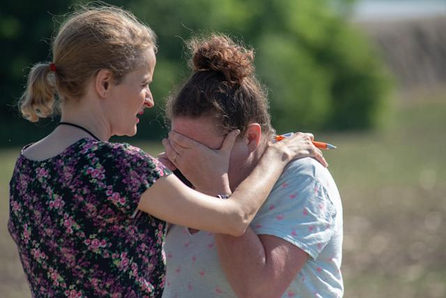 <p>Substitute teacher Joanie Lynne, (L) consoles instructional assistant Paige Rose outside Noblesville West Middle School after a shooting at the school on May 25, 2018 in Noblesville, Ind. (Photo: Kevin Moloney/Getty Images) </p>