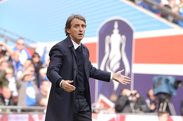 Manchester City manager Roberto Mancini reacts on the touchline