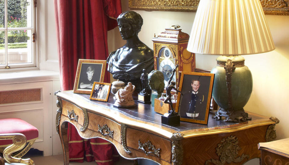 A portrait of Prince Harry (right) sits far apart from his brother, Prince William on a wooden desk Inside The Garden Room in Clarence House. Photo: Twitter/ClarenceHouse.