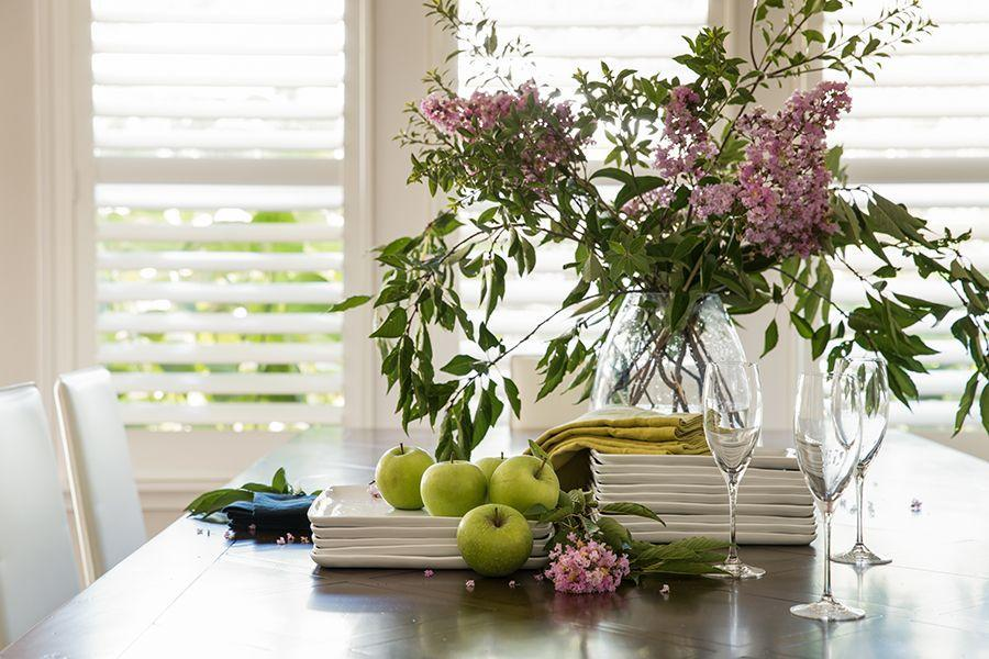 """<p>""""I would recommend using blossoms and branches from your own garden to create dimension and interest to the table. I love using different shades of greens and pinks for spring, while introducing fresh produce to add an unexpected element. Tying in colored linen napkins adds the finishing touch to a beautiful Easter table."""" <em>—<a href=""""http://www.kristemichelini.com/"""" rel=""""nofollow noopener"""" target=""""_blank"""" data-ylk=""""slk:Kriste Michelini"""" class=""""link rapid-noclick-resp"""">Kriste Michelini</a>, Interior Designer</em></p>"""