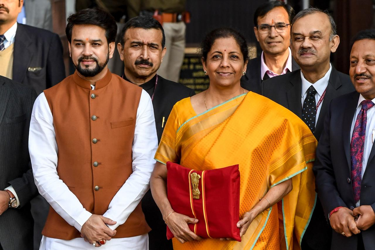 India's Finance Minister Nirmala Sitharaman (3R) looks on as she leaves the Finance Ministry for the Parliament to announce the 2020-21 union budget, in New Delhi on February 1, 2020. (Photo by Prakash SINGH / AFP) (Photo by PRAKASH SINGH/AFP via Getty Images)