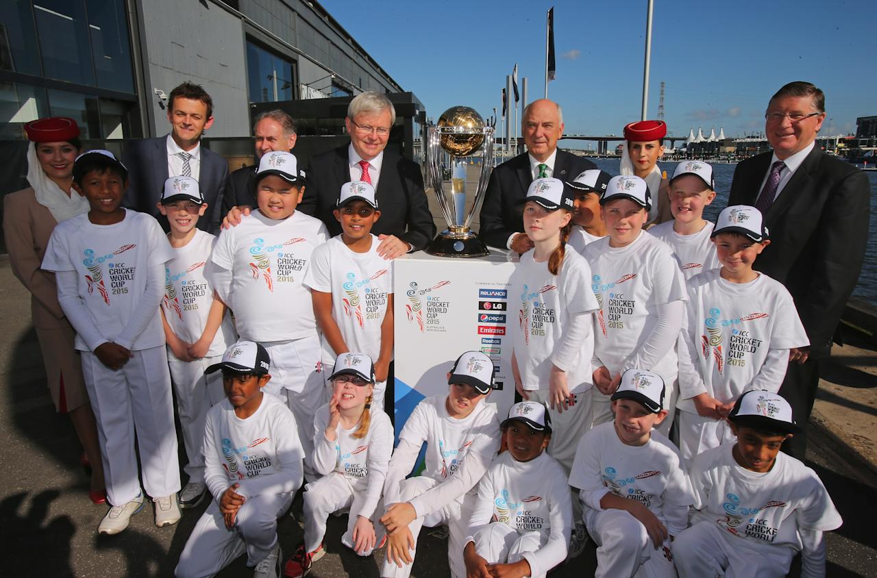 MELBOURNE, AUSTRALIA - JULY 30:  Former Australian cricketer Adam Gilchrist, Australian Prime Minister Kevin Rudd, Ralph Waters, Chairman, ICC Cricket World Cup 2015 and Premier of Victoria, Denis Napthine pose with the ICC Cricket World Cup trophy during the Official Launch of the ICC Cricket World Cup 2015 on July 30, 2013 in Melbourne, Australia.  (Photo by Scott Barbour/Getty Images)