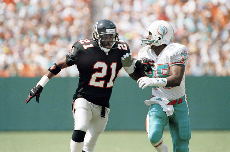 Atlanta Falcons defensive back Deion Sanders covers Miami Dolphins wide receiver Mark Duper during a game at the Orange Bowl, Oct. 11, 1992. (AP Photo)
