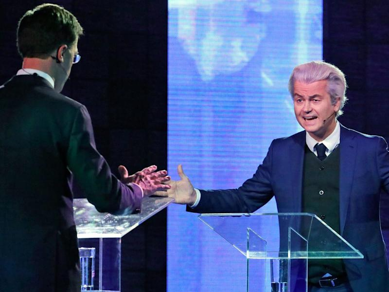 Mr Wilders and Mr Rutte debate in the first head-to-head meeting of the two political party leaders since the start of the election campaign (Reuters)