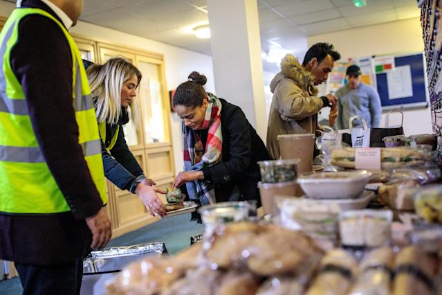 Volunteers from a food waste charity deliver surplus food collected from central London sandwich shops to a local shelter. (Jack Taylor/Getty Images)