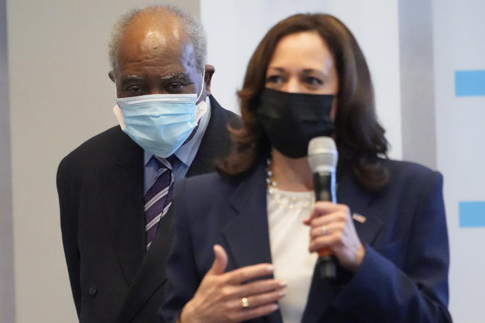 Vice President Kamala Harris speaks during a visit to a COVID-19 vaccination site Tuesday, April 6, 2021, in Chicago, as Rep. Danny Davis, D-Ill., listens. The site is a partnership between the City of Chicago and the Chicago Federation of Labor. (AP Photo/Jacquelyn Martin)
