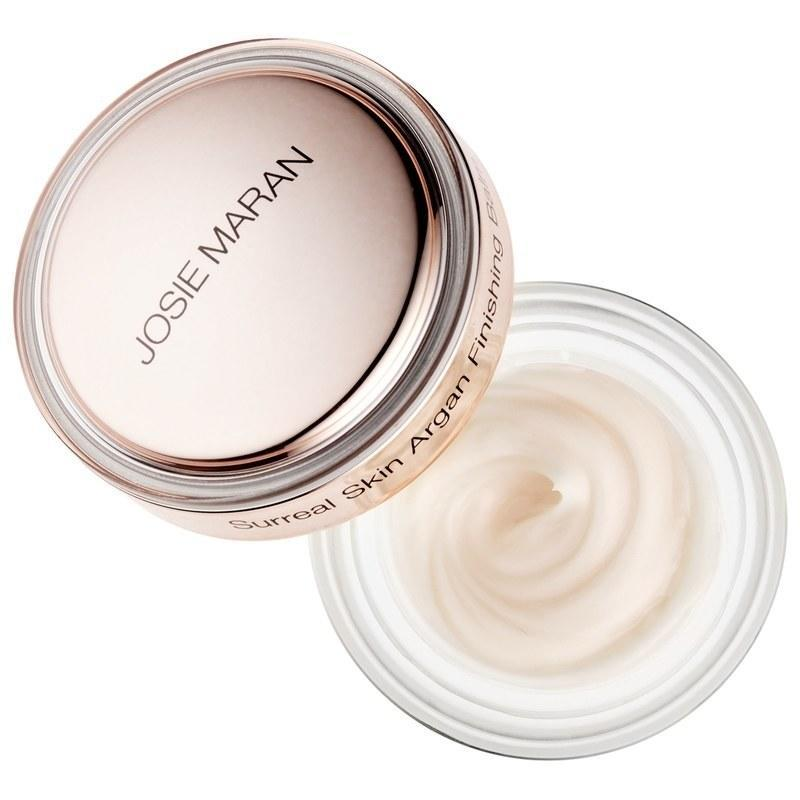 "Another way to get that ""base glow"" going? Use a moisturizing cream that also functions as a primer. Josie Maran's finishing balm moisturizes and tightens skin while smoothing it for makeup application. You can also use it throughout the day as a highlighter: Just tap it onto cheekbones and the bridge of your nose. It's so great, it's one of <a href=""http://www.glamour.com/story/why-the-josie-maran-surreal-skin-argan-finishing-balm-is-a-top-seller-at-sephora?mbid=synd_yahoo_rss"" rel=""nofollow noopener"" target=""_blank"" data-ylk=""slk:Sephora's top sellers"" class=""link rapid-noclick-resp"">Sephora's top sellers</a>! $36, Josie Maran Surreal Skin Argan Finishing Balm. <a href=""https://shop-links.co/1674787267363564348"" rel=""nofollow noopener"" target=""_blank"" data-ylk=""slk:Get it now!"" class=""link rapid-noclick-resp"">Get it now!</a>"