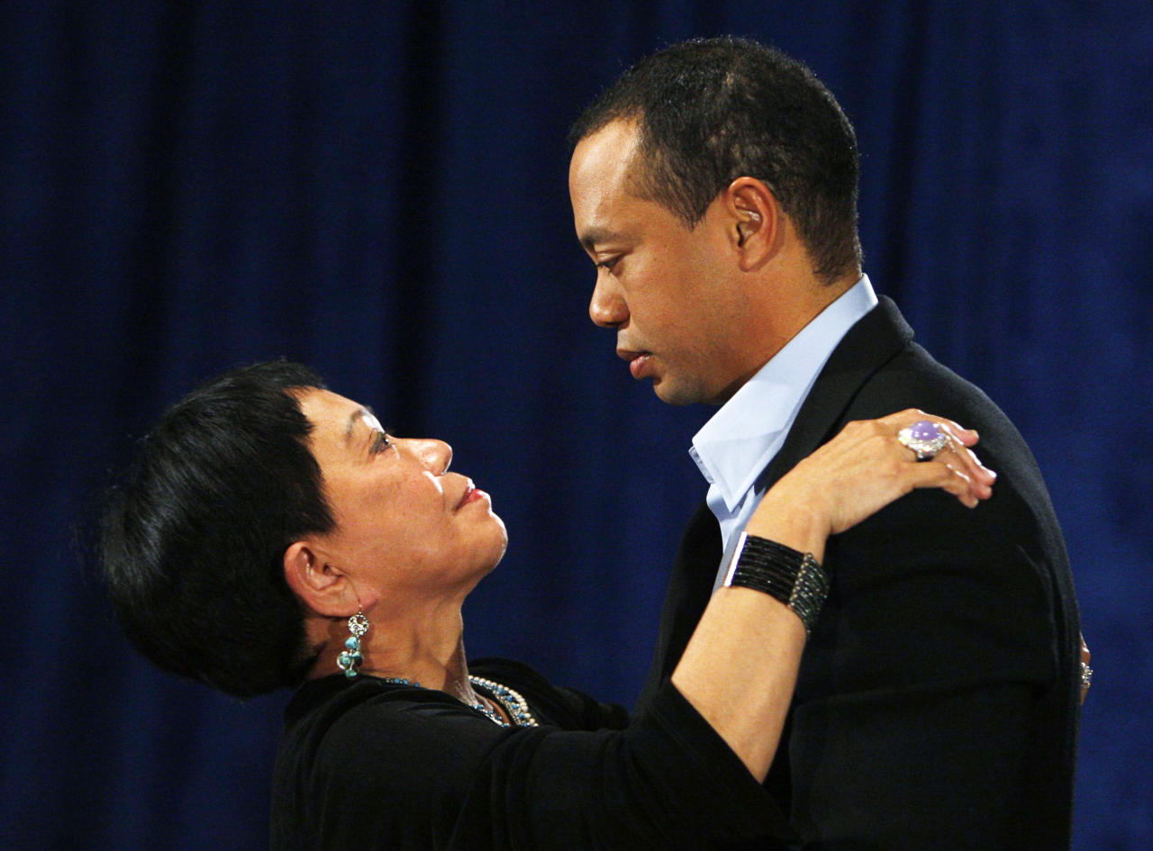 Tiger Woods talks his mother Kultida following a statement from the Sunset Room on the second floor of the TPC Sawgrass, home of the PGA Tour on February 19, 2010 in Ponte Vedra Beach, Florida. Woods publicly admitted to cheating on his wife Elin Nordegren but maintained that the issues remain 'a matter between a husband and a wife.' (Photo by Joe Skipper-Pool/Getty Images)
