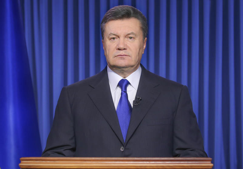 "File- This Feb. 19, 2014, file photo shows Ukrainian President Viktor Yanukovych addressing the nation on a live TV broadcast in Kiev, Ukraine. The fugitive president said in a statement published by three Russian news agencies that he is asking Russia's protection from ""extremists."" Yanukovych, who fled from Ukraine's capital Kyiv last week, said in the Thursday, Feb. 27, 2014, statement that he still considers himself to be the legitimate leader. (AP Photo/Andrei Mosienko, Pool, File)"