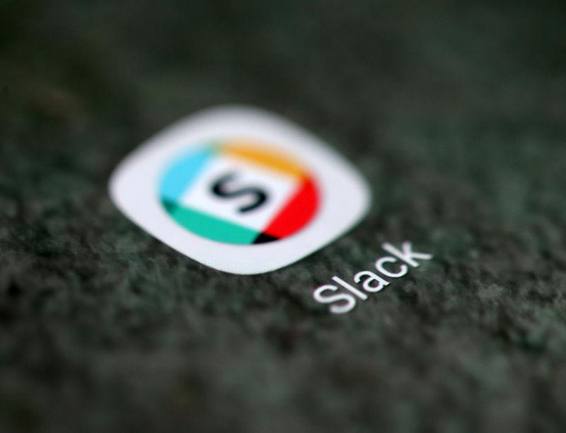 The Slack app logo is seen on a smartphone in this illustration