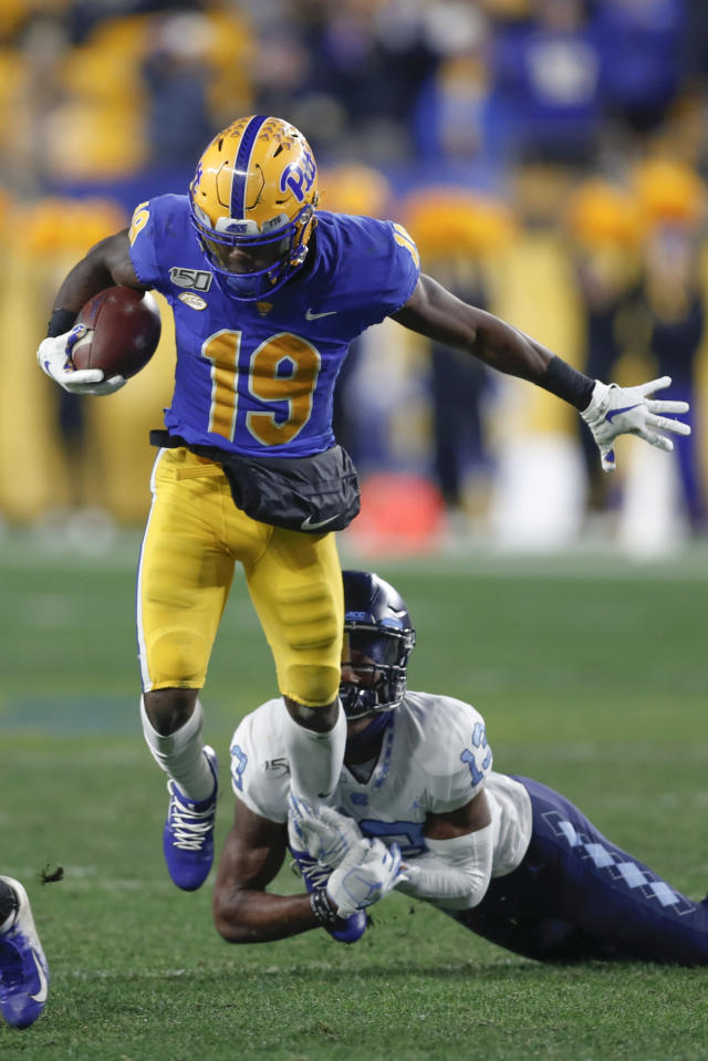 Pittsburgh wide receiver V'Lique Carter (19) tries to break a tackle by North Carolina defensive back Don Chapman ,bottom, during the first half of an NCAA football game, Thursday, Nov. 14, 2019, in Pittsburgh. (AP Photo/Keith Srakocic)