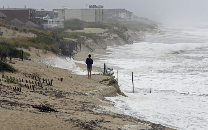 <p>Heavy surf crashes the dunes at high tide in Nags Head, N.C., Sept. 13, 2018 as Hurricane Florence approaches the east coast. (Photo: Gerry Broome/AP) </p>