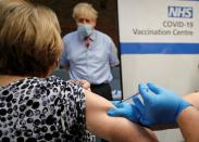 British Prime Minister Boris Johnson visits Guy's Hospital on the first day of administering a coronavirus vaccine in London