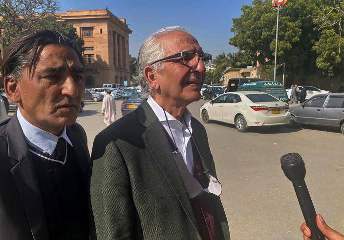 Mehmood A. Sheikh, center, a defense lawyer for British-born Pakistani Ahmed Omar Saeed Sheikh, Ahmed Omar Saeed Sheikh, who is charged in the 2002 murder of American journalist Daniel Pearl, talks to a journalists outside the Sindh High Court, in Karachi, Pakistan, Thursday, Dec. 24, 2020. The provincial court overturned a Supreme Court Decision that Sheikh should remain in custody during an appeal of his acquittal on charges he murdered Pearl. (AP Photo/Adil Jawad)