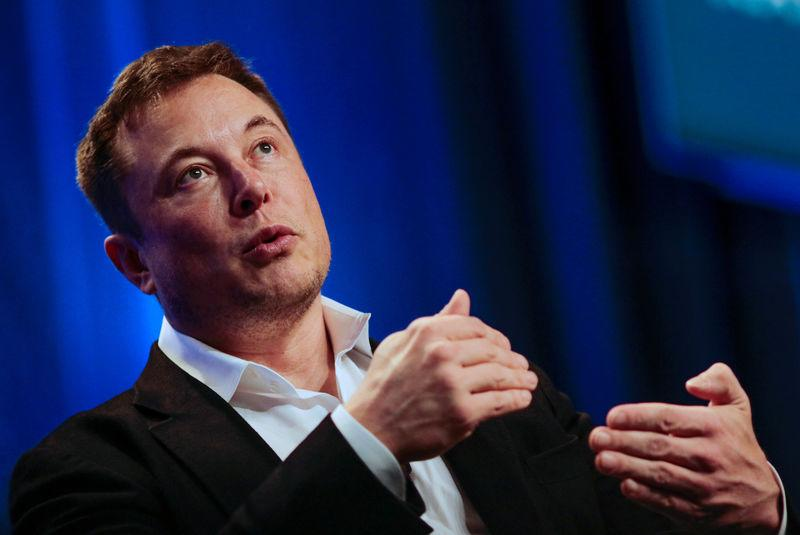 """FILE PHOTO - Tesla and SpaceX CEO Musk speaks in a """"fireside chat"""" at the NLC 2018 City Summit in Los Angeles"""