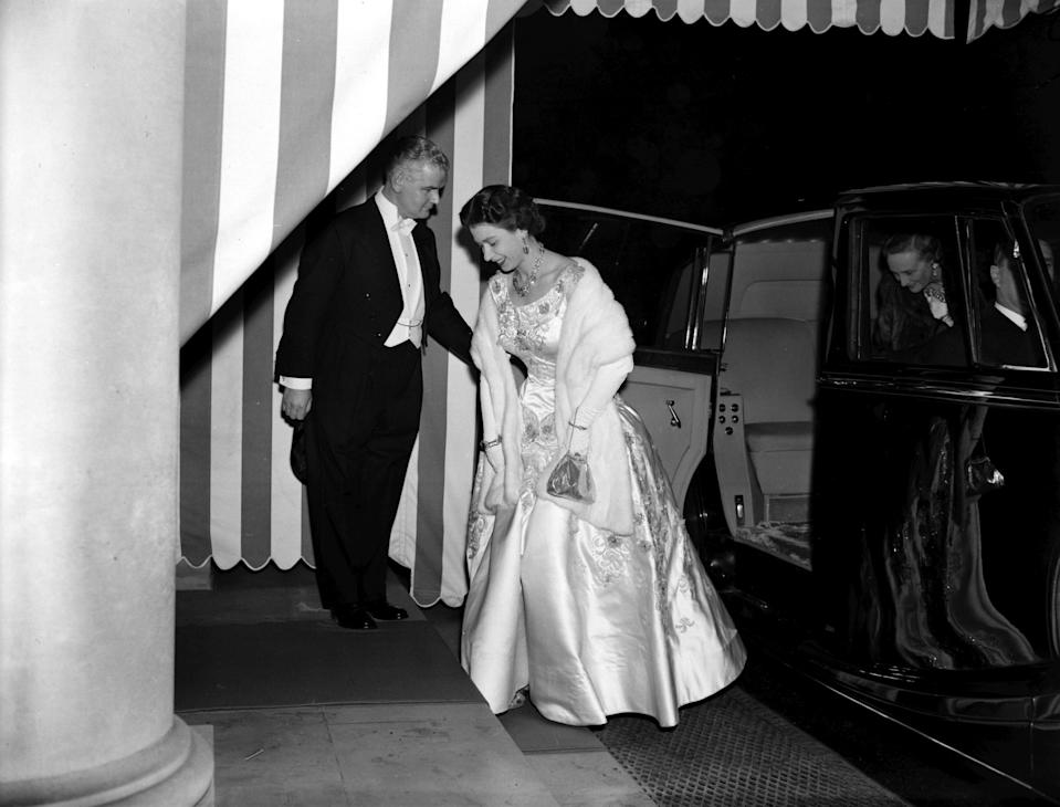 Queen Elizabeth II arrives at Winfield House, the American Ambassador's residence in Regent's Park, London, to attend a Thanksgiving Day dinner given by American Vice-President Richard Nixon.