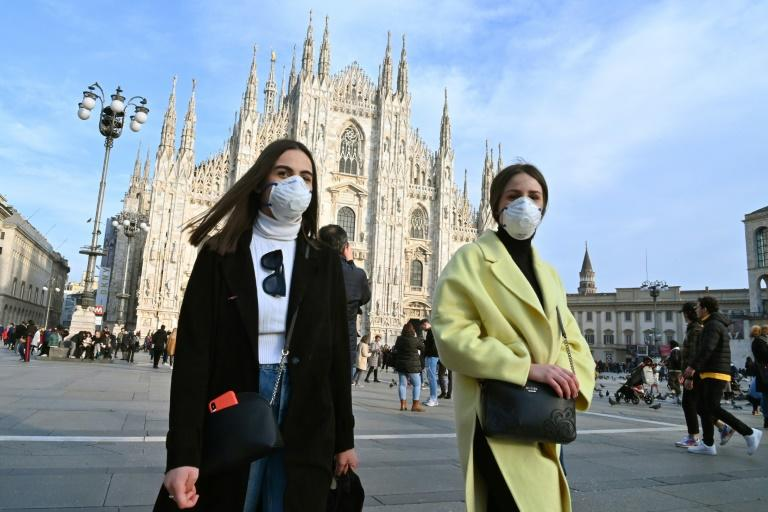 Italy has placed some 50,000 people in a dozen small northern towns in lockdown but the fallout has spread to nearby Milan, where concerns over the spread of coronavirus have disrupted events from Milan fashion Week to opera at La Scala and football (AFP Photo/ANDREAS SOLARO)