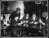 <p>Workmen play games and drink beer by candlelight at a pub during a strike by Leeds municipal workers.<br></p>