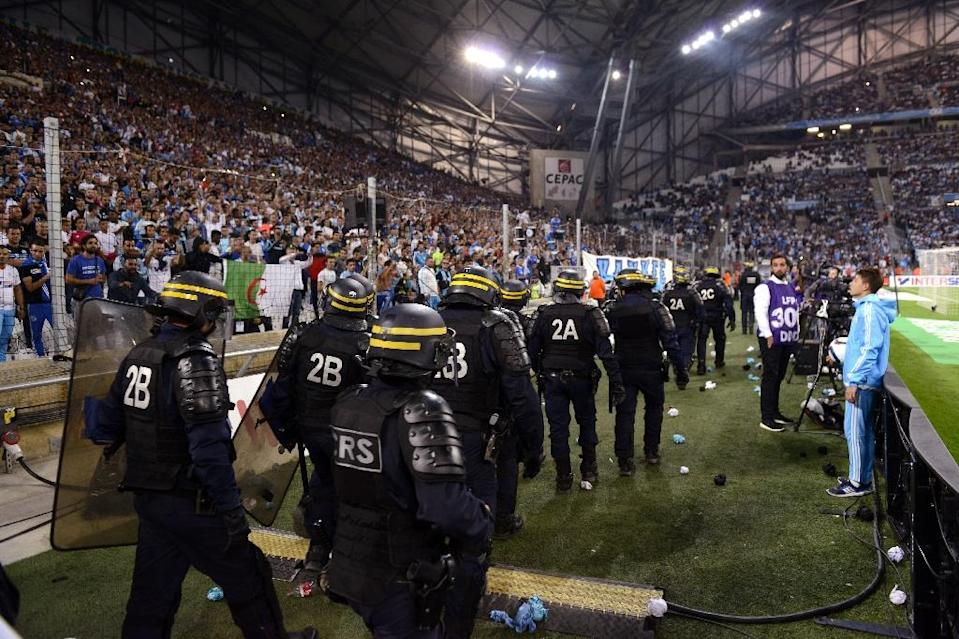 Riot police are pictured during a game interruption at the French L1 football match Marseille vs Lyon on September 20, 2015 at Velodrome Stadium (AFP Photo/Franck Pennant)
