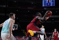 Germany's Isaac Bonga (0), right, drives to the basket past Slovenia's Luka Doncic (77), left, during men's basketball quarterfinal game at the 2020 Summer Olympics, Tuesday, Aug. 3, 2021, in Saitama, Japan. (AP Photo/Charlie Neibergall)