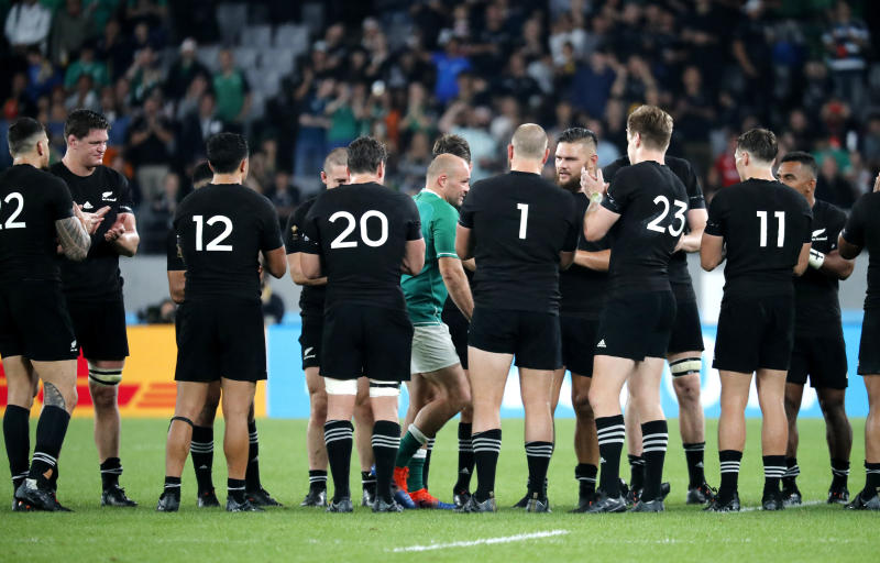 Ireland's Rory Best is given a send-off by New Zealand's players after the Rugby World Cup quarterfinal match at Tokyo Stadium in Tokyo, Japan, Saturday, Oct. 19, 2019. (AP Photo/Eugene Hoshiko)