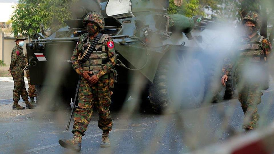 Myanmar soldiers patrol the street during a demonstration against the military coup outside the Central Bank in Yangon, Myanmar