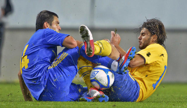 Ukraine's Ievgenii Shakhov (L) collides with Sweden's Astrit Ajdarevic during the U21 European Football Championships qualification match Sweden vs Ukraine in Kalmar on September 10, 2012. AFP PHOTO/ SCANPIX/ PATRIC SODERSTROM ***SWEDEN OUT***Patric Soderstrom/AFP/GettyImages