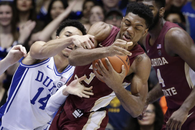 Duke guard Jordan Goldwire (14) reaches for the ball while Florida State guard Trent Forrest (3) grabs a rebound during the second half of an NCAA college basketball game in Durham, N.C., Monday, Feb. 10, 2020. (AP Photo/Gerry Broome)