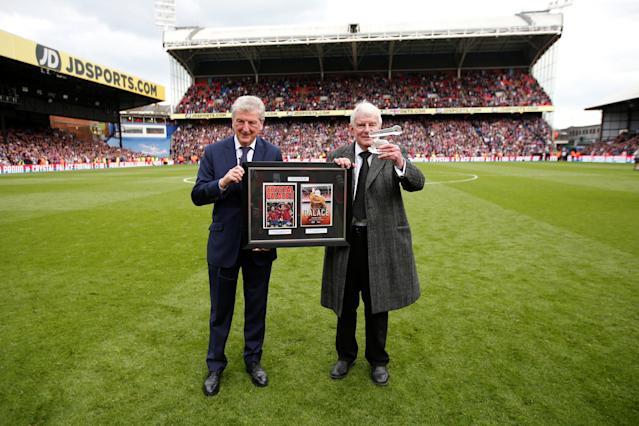 "Soccer Football - Premier League - Crystal Palace vs West Bromwich Albion - Selhurst Park, London, Britain - May 13, 2018 Crystal Palace manager Roy Hodgson presents an award to Commentator John Motson after the match Action Images via Reuters/Matthew Childs EDITORIAL USE ONLY. No use with unauthorized audio, video, data, fixture lists, club/league logos or ""live"" services. Online in-match use limited to 75 images, no video emulation. No use in betting, games or single club/league/player publications. Please contact your account representative for further details."