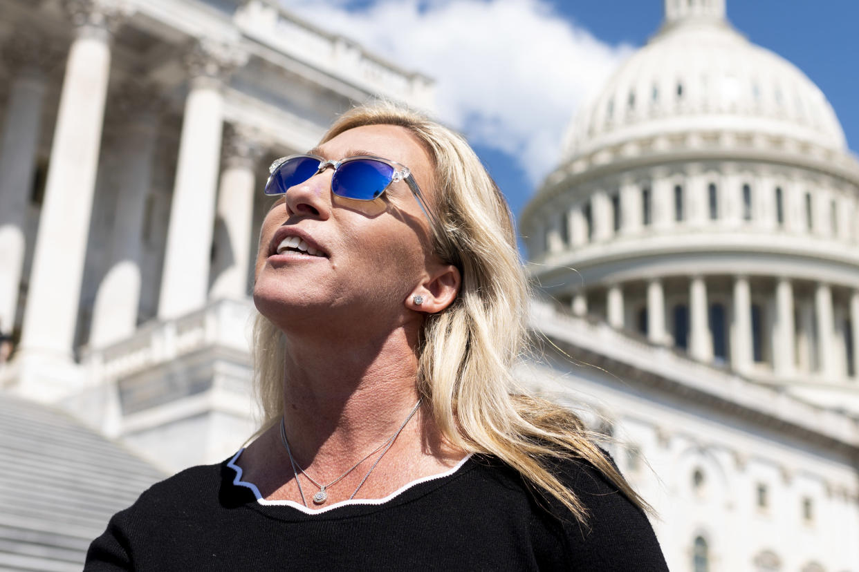 UNITED STATES - MAY 14: Rep. Marjorie Taylor Greene, R-Ga., speaks to reporters about her recent interaction with Alexandria Ocasio-Cortez, D-N.Y., as she leaves the Capitol after the last vote of the week on Friday, May 14, 2021. (Photo by Bill Clark/CQ-Roll Call, Inc via Getty Images)