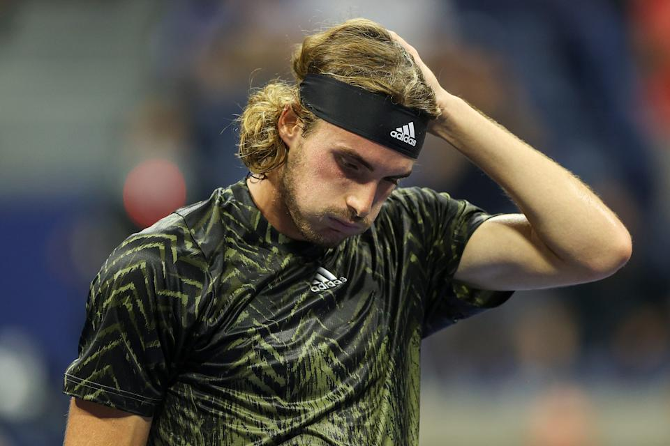 NEW YORK, NEW YORK - AUGUST 30:  Stefanos Tsitsipas of Greece reacts against Andy Murray of United Kingdom during their men's singles first round match on Day One of the 2021 US Open at the Billie Jean King National Tennis Center on August 30, 2021 in the Flushing neighborhood of the Queens borough of New York City. (Photo by Elsa/Getty Images)