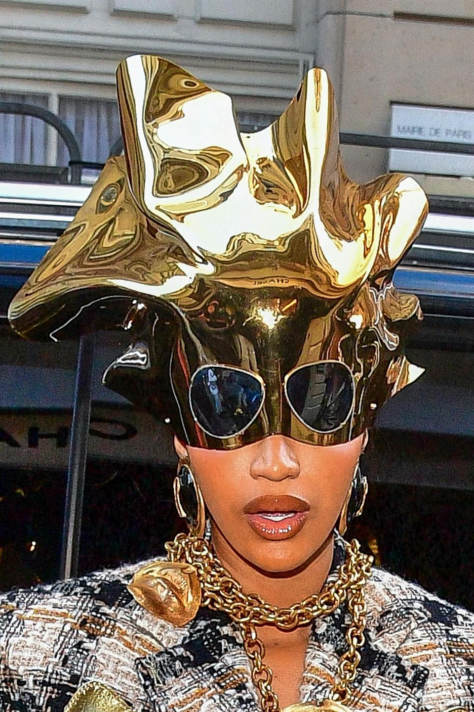 Close-up of Cardi's gold headpiece, with attached sunglasses