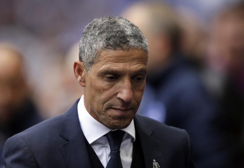 Brighton manager Chris Hughton walks to the bench at the start of the English FA Cup semifinal soccer match between Manchester City and Brighton & Hove Albion at Wembley Stadium in London, Saturday, April 6, 2019. (AP Photo/Tim Ireland)