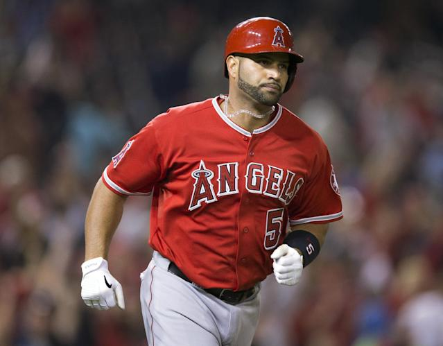Los Angeles Angels Albert Pujols (5) begins to circle the bases after hitting his career 500th home run against Washington Nationals Taylor Jordan in the fifth inning of a baseball game in Washington, Tuesday, April 22, 2014. (AP Photo/Pablo Martinez Monsivais)