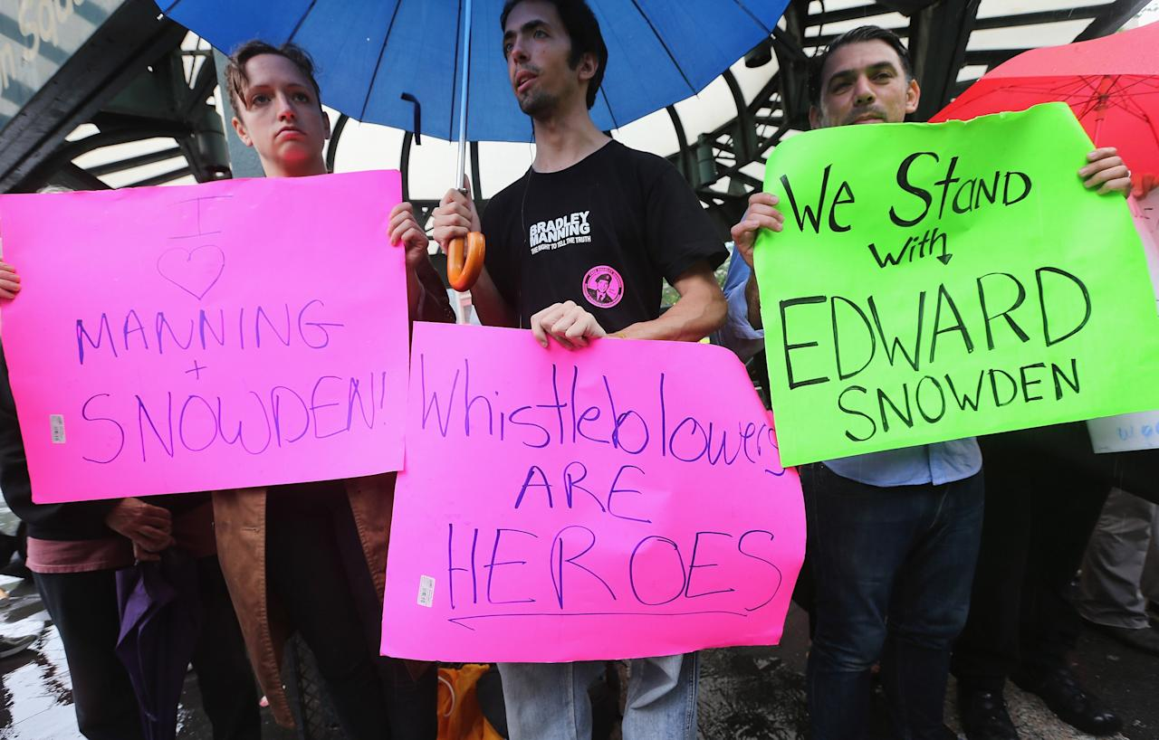 NEW YORK, NY - JUNE 10:  Supporters gather at a small rally in support of National Security Administration (NSA) whistleblower Edward Snowden in Manhattan's Union Square on June 10, 2013 in New York City. About 15 supporters attended the rally a day after Snowden's identity was revealed in the leak of the existence of NSA data mining operations.  (Photo by Mario Tama/Getty Images)
