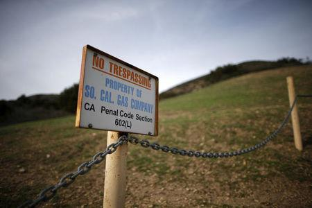 FILE PHOTO - A gas company sign marks a fence near the site of the Aliso Canyon storage field where gas has been leaking in Porter Ranch, California, United States, January 21, 2016. REUTERS/Lucy Nicholson/File Photo