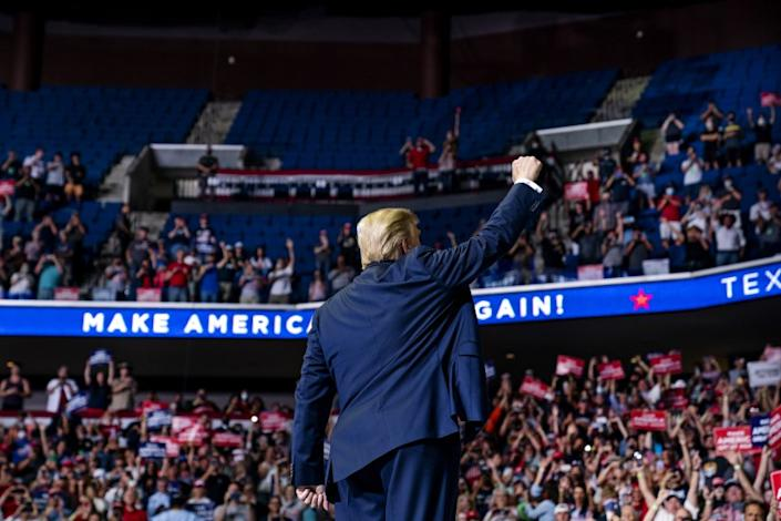 "President Donald Trump arrives on stage to speak at Saturday's campaign rally at the BOK Center in Tulsa, Okla. <span class=""copyright"">(Evan Vucci / Associated Press)</span>"