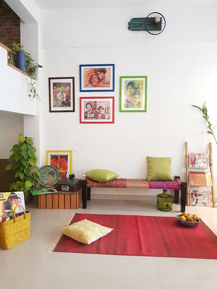 A section of the living area on the ground level is a tribute to the homeowners' love of classic Bollywood films and music.