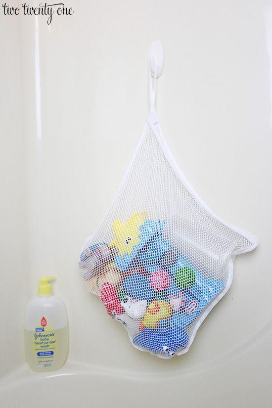 """<p>Bath toys can be a challenge to store since they're wet 99% of the time. A mesh bag contains the problem while letting toys dry out (for once). </p><p><a href=""""http://www.twotwentyone.net/toy-organization-ideas/"""" rel=""""nofollow noopener"""" target=""""_blank"""" data-ylk=""""slk:See more at Two Twenty One »"""" class=""""link rapid-noclick-resp""""><em>See more at Two Twenty One »</em></a></p>"""