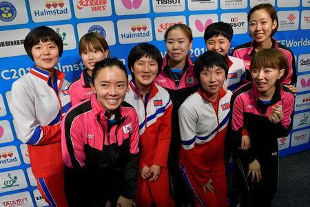 South Korean and North Korean teams pose after deciding to form a unified Korean team for the upcoming semi-finals at the World Team Table Tennis Championships 2018, at Halmstad Arena in Halmstad, Sweden May 3, 2018. TT News Agency/Jonas Ekstromer/via REUTERS