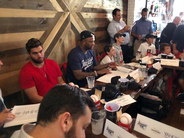 "<a class=""link rapid-noclick-resp"" href=""/mlb/players/6603/"" data-ylk=""slk:CC Sabathia"">CC Sabathia</a> (center) hosts his fantasy draft on Yahoo as part of the Big League Impact initiative. (Yahoo)"