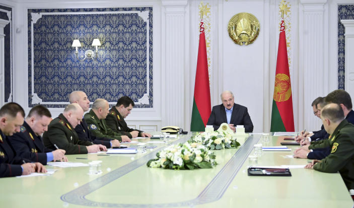 Belarusian President Alexander Lukashenko attends a meeting with top officials of the country's security agencies in Minsk, Belarus, Saturday, Sept. 12, 2020. Throughout the unrest, he has rejected any concessions, has repeatedly accused Belarus' western neighbors of preparing to overthrow his government and has made shows of aggressive defiance, including striding with an automatic rifle across the grounds of his presidential residence. (Andrei Stasevich/BelTA Pool Photo via AP)